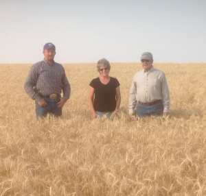From left to right: Evan Lesser, Barb Grecian and Ken Grecian at the Grecian's Farm.